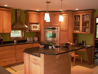 Kitchen remodeled with countertop window, desk area and custom island