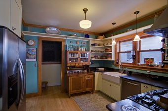 Kitchen remodel centering around antique pie cabinet