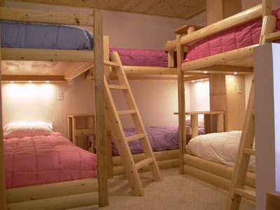 Rustic bunk beds were handcrafted by Adams Design Construction, Ltd.